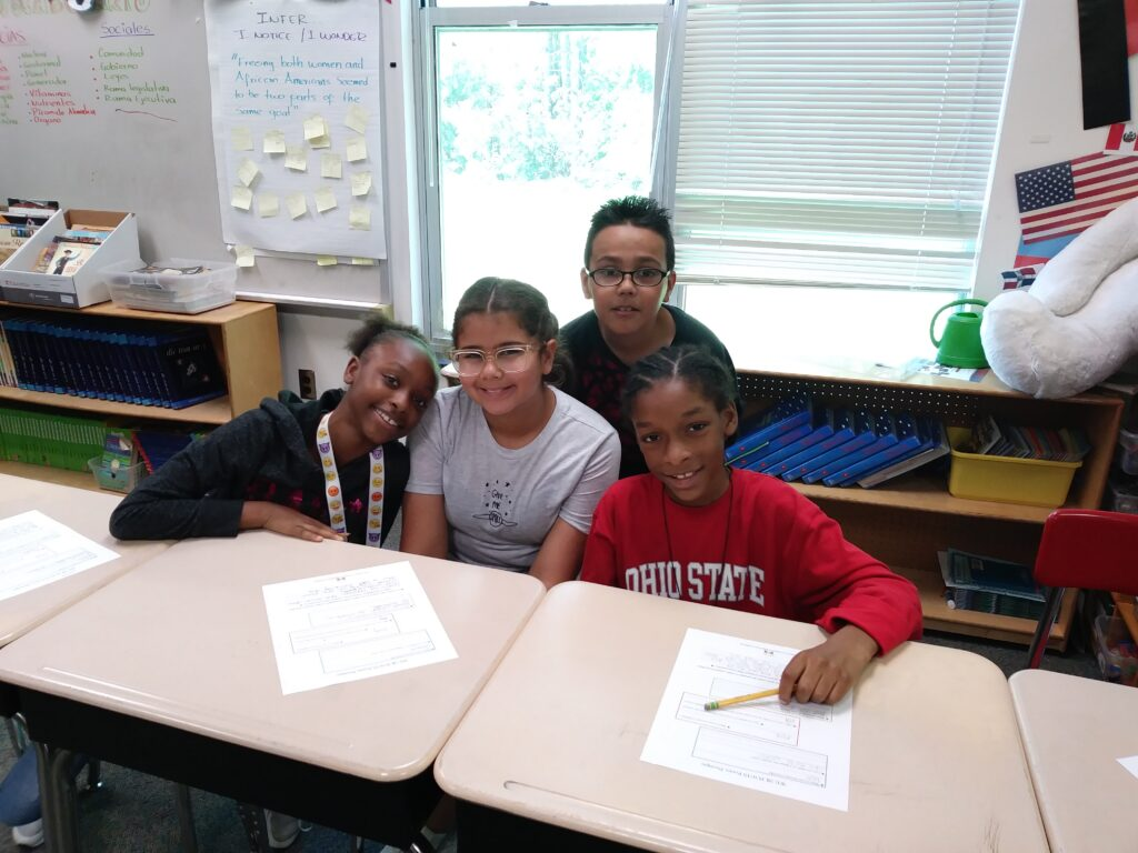 Students participate in the We 2 R Poets project at Hodge Road Elementary
