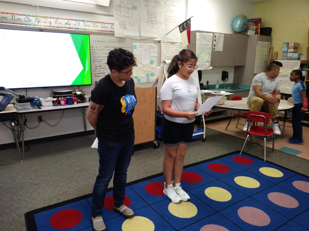 Michelle Rosquillo and a student at Hodge Road Elementary during our We 2 R Poets workshop